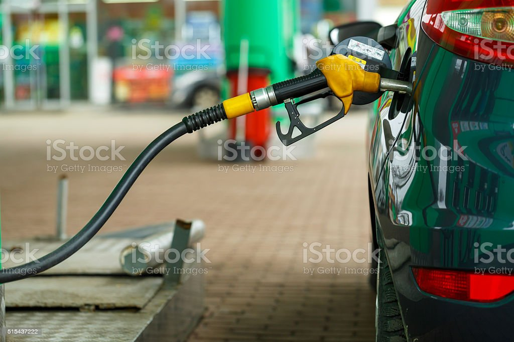 Car refueling on a petrol station stock photo