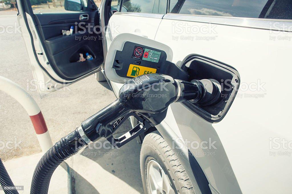 Car refueling on petrol station. stock photo