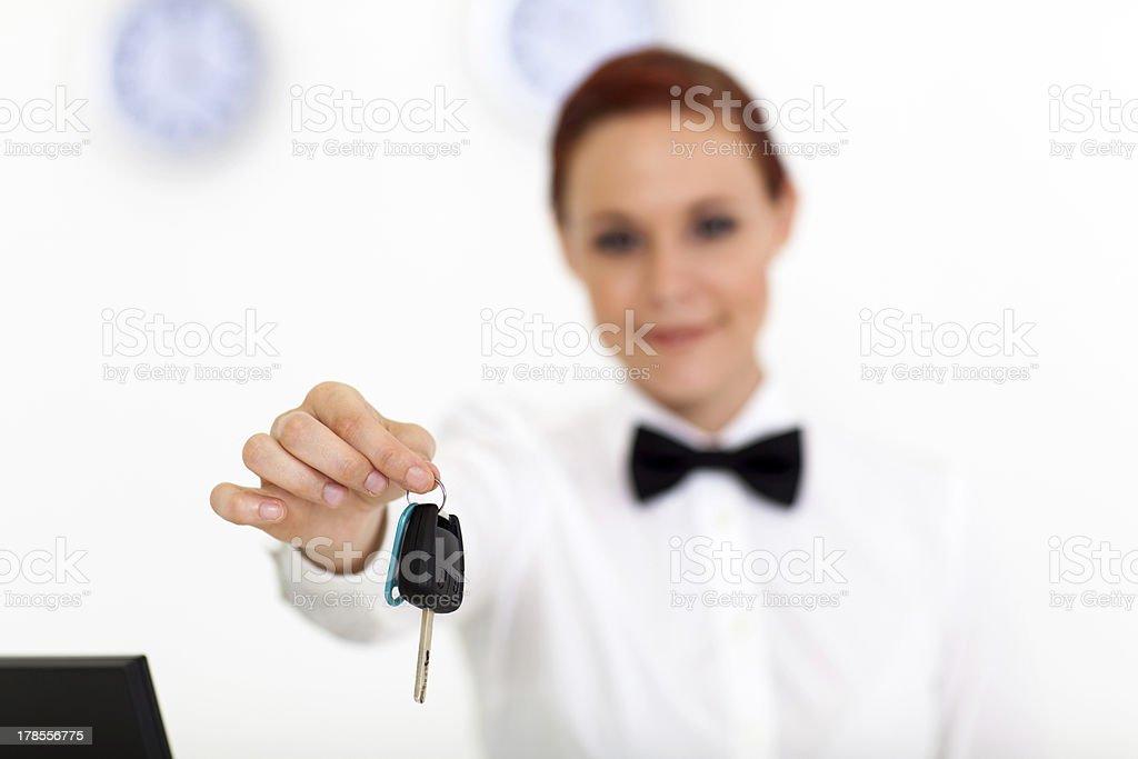 car rental company employee hand over key stock photo