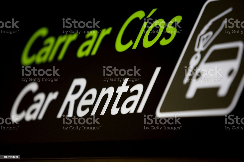 A car rental sign with a picture of a car and key royalty-free stock photo