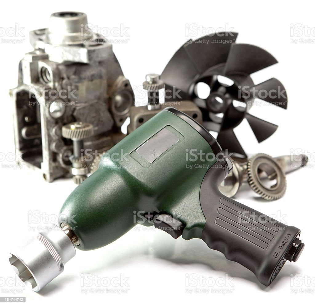 Car repair details and air impact wrench on white background stock photo