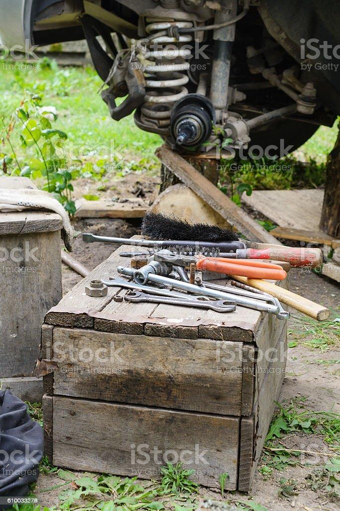 car repair in the field stock photo