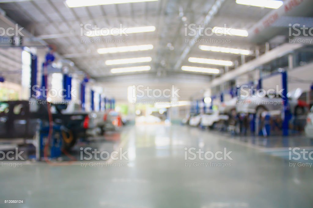car repair service center blurred background stock photo