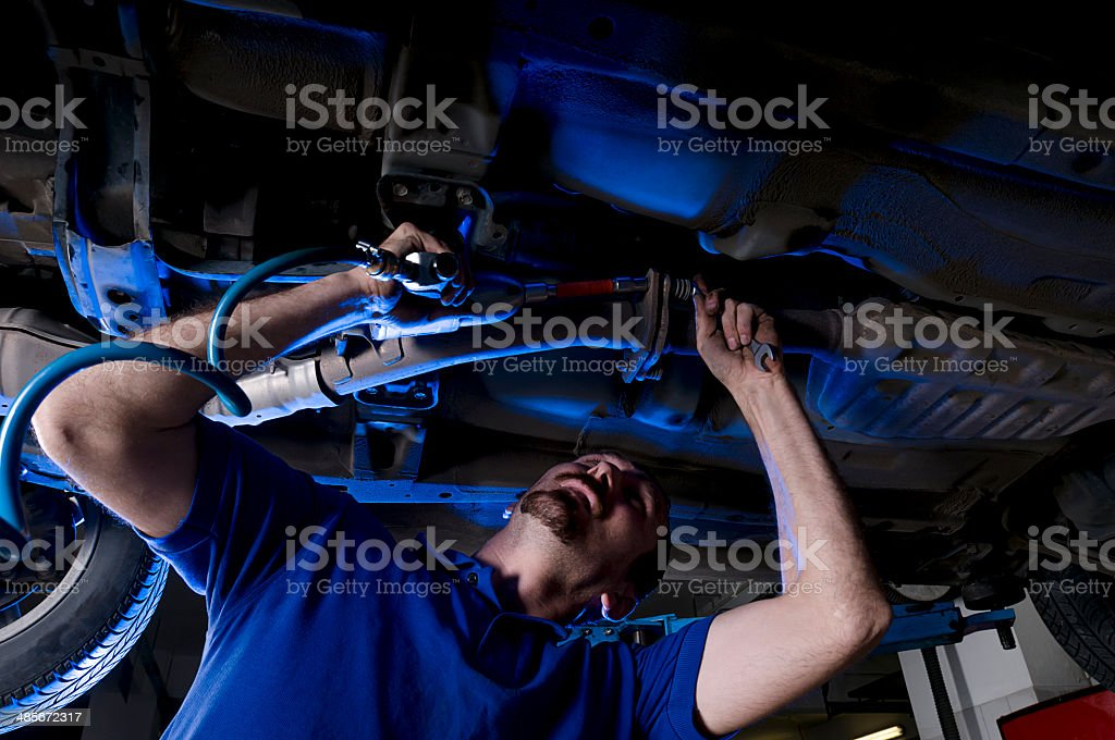 Car Repairman at Garage stock photo