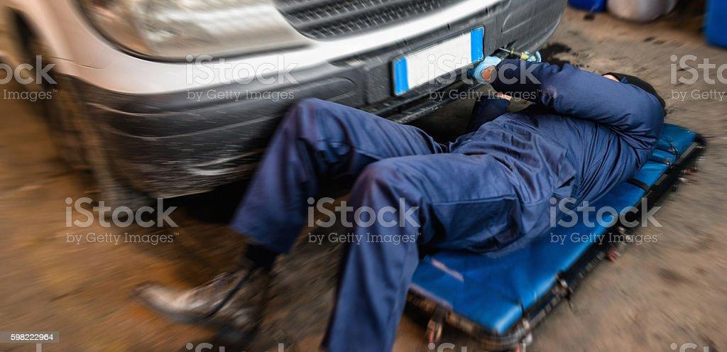 car repairman on the garage stock photo