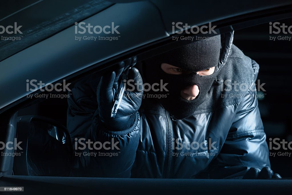 Car robber at night stock photo