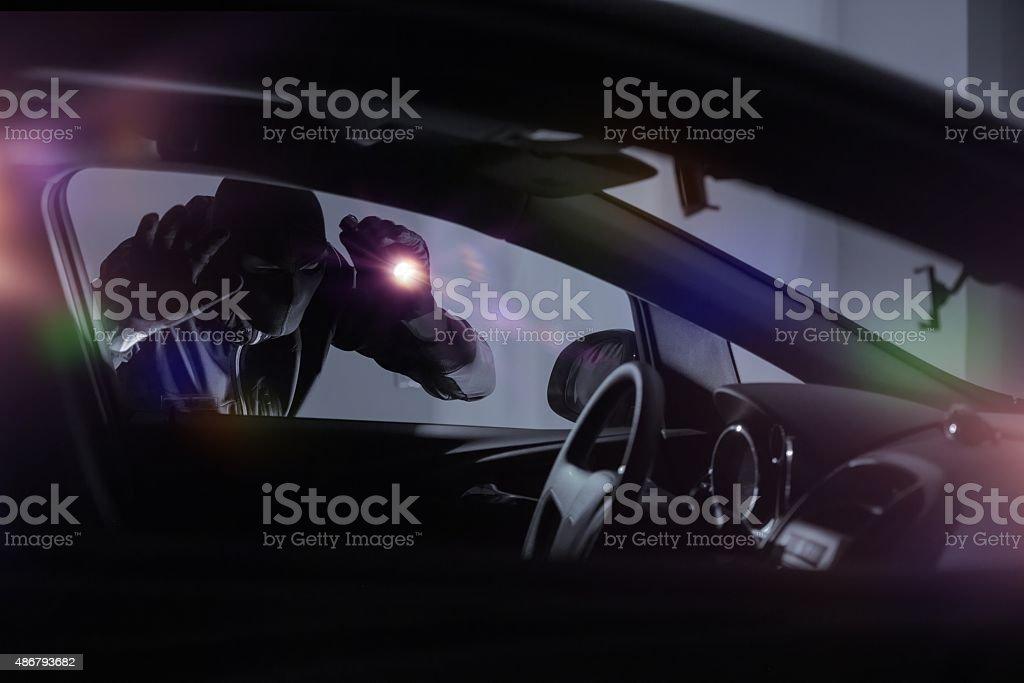 Car Robber with Flashlight stock photo
