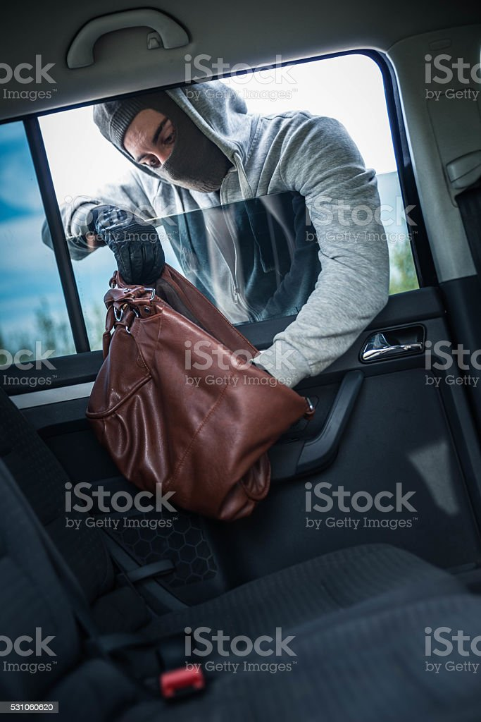 Car robbery stock photo