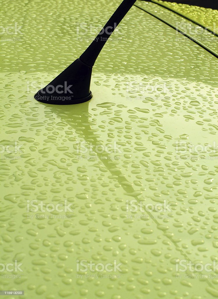 Car rooftop abstract - Close-up of antenna with rain drops royalty-free stock photo