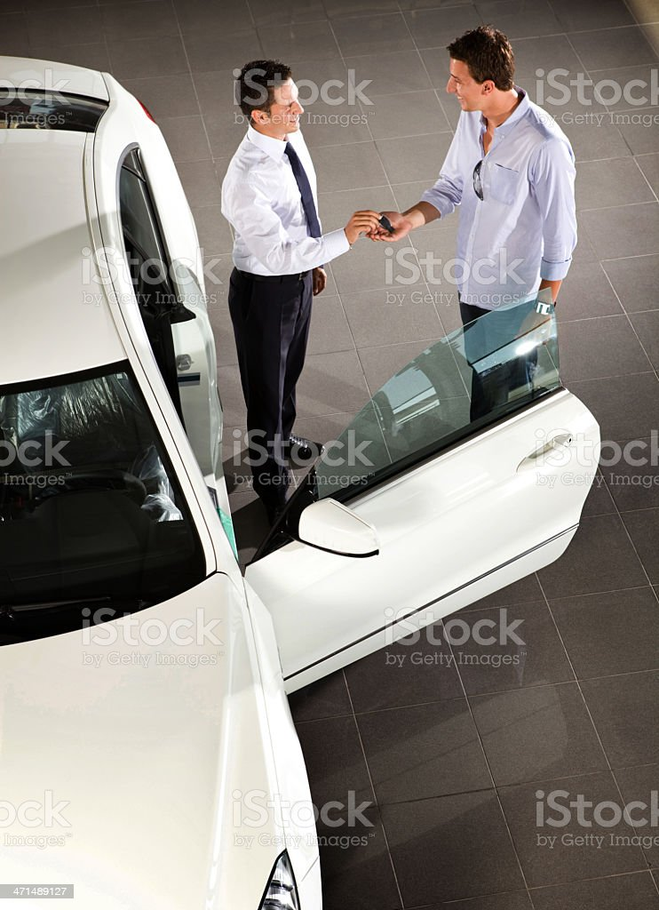 Car Salesman and Buyer royalty-free stock photo