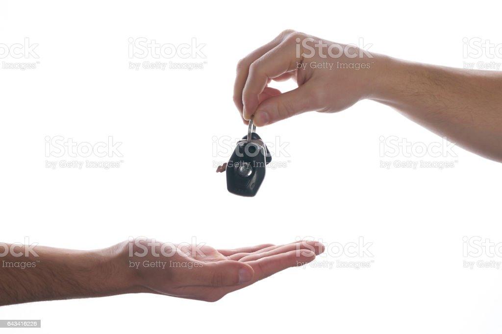 Car salesman handing over the keys for a new car stock photo