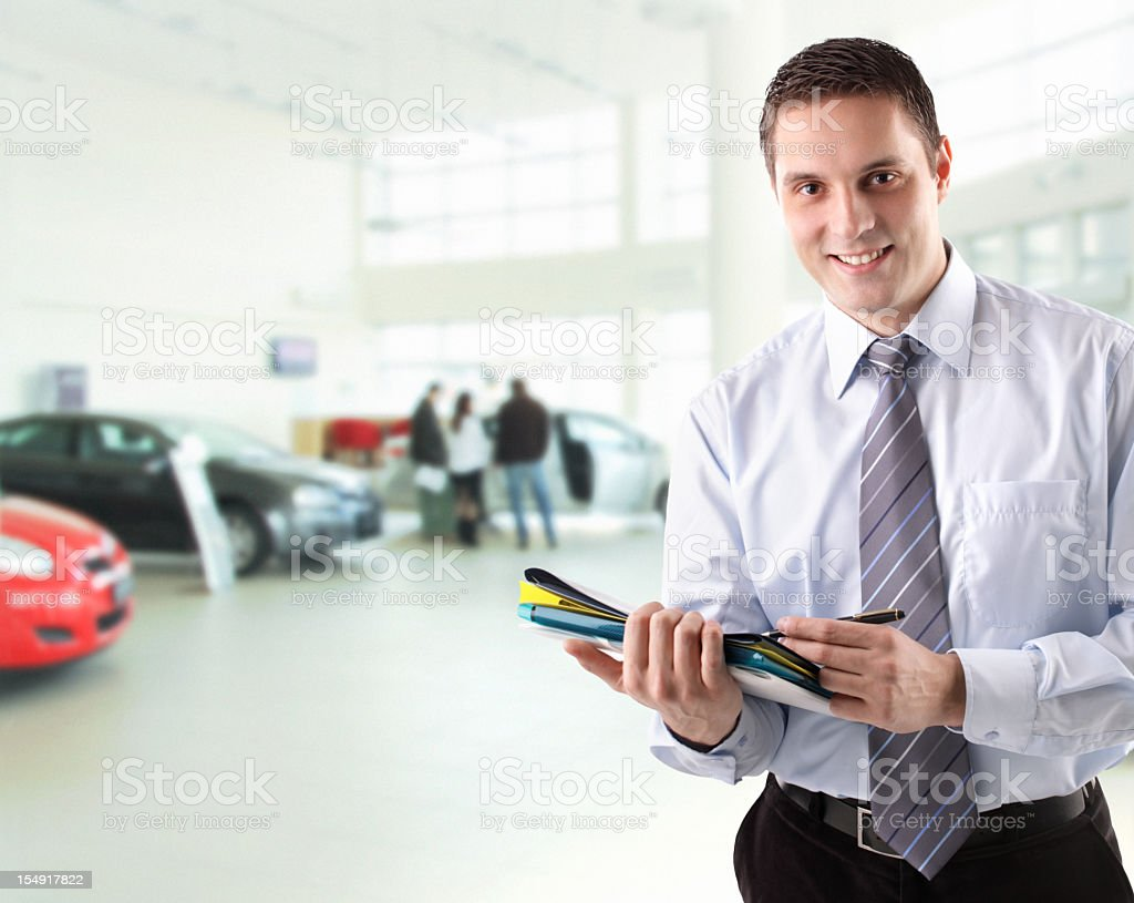 Car salesman. stock photo