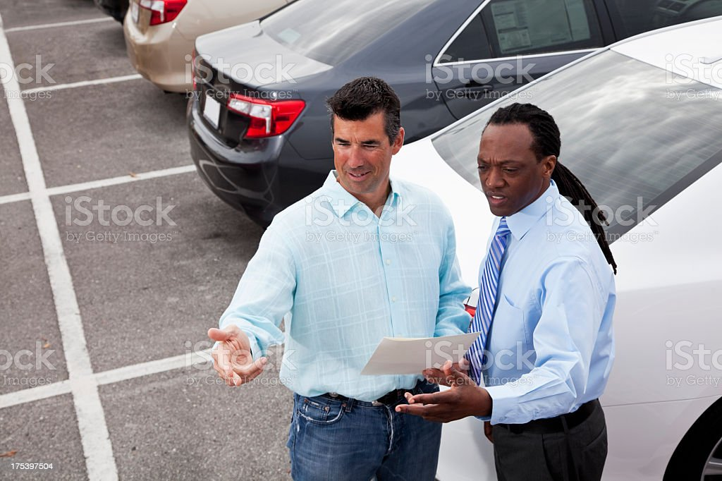 Car salesman with a customer stock photo