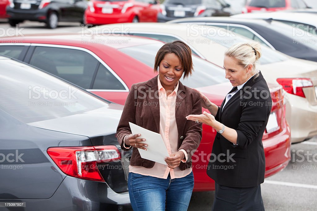 Car salesperson with a customer stock photo