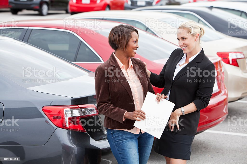Car salesperson with a customer royalty-free stock photo