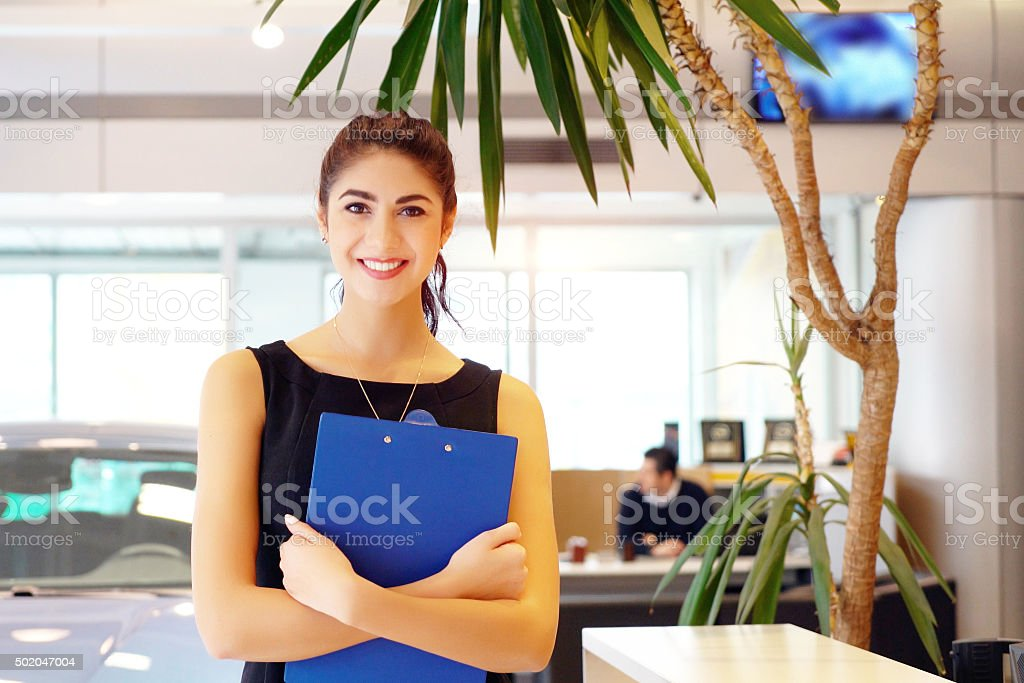 car saleswoman stock photo