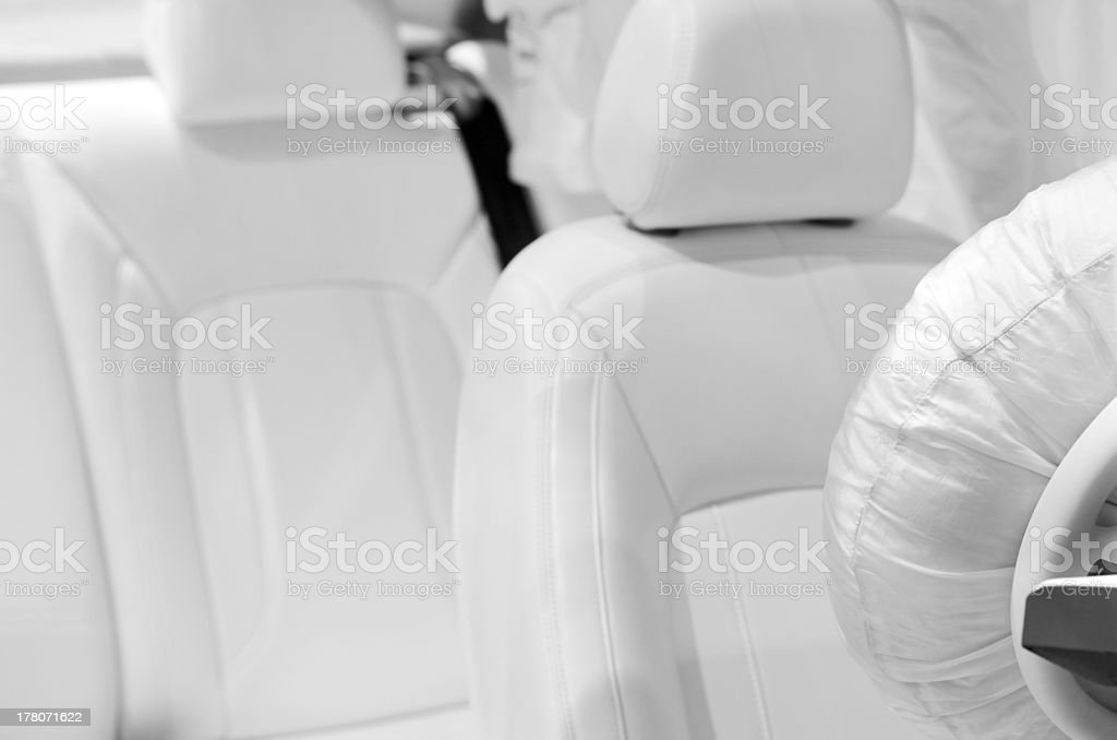 Car seat and airbag covered in white material stock photo