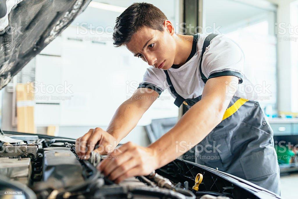 Car Service, Mechanic at Work stock photo