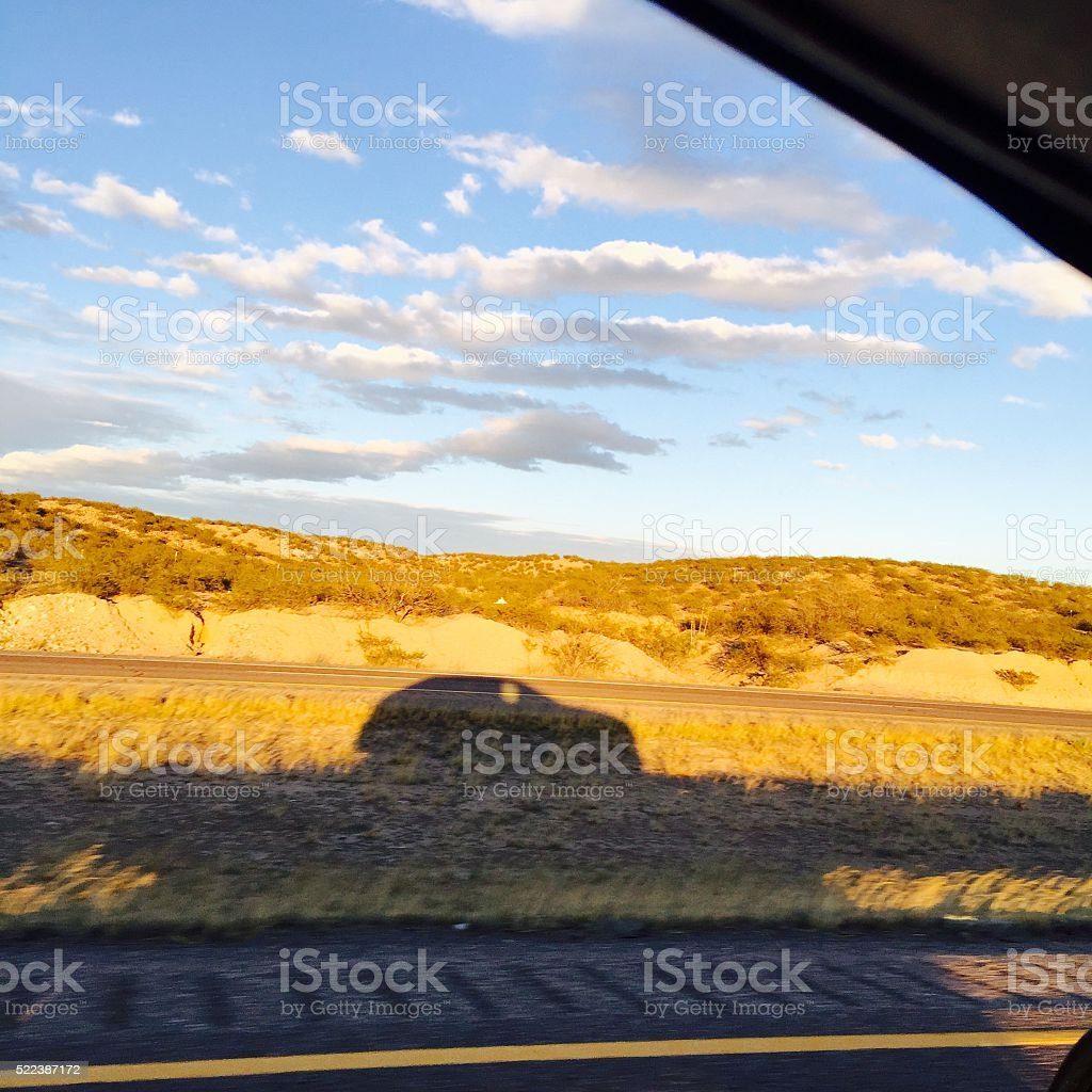 Car shadow at sunset stock photo