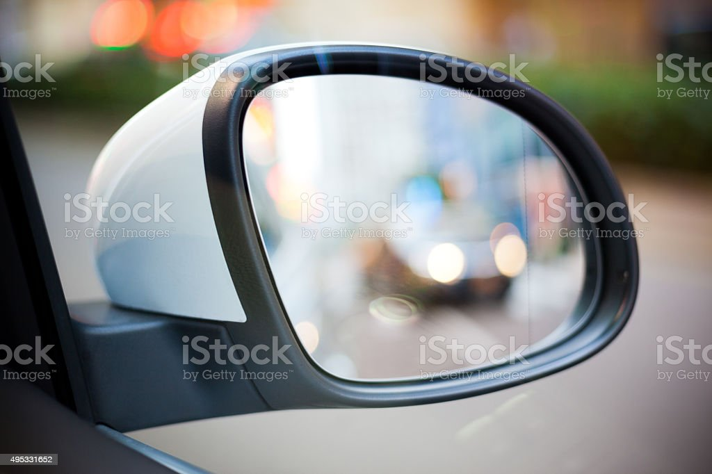 Car Side Rear-View Mirror with City Street View Reflection stock photo