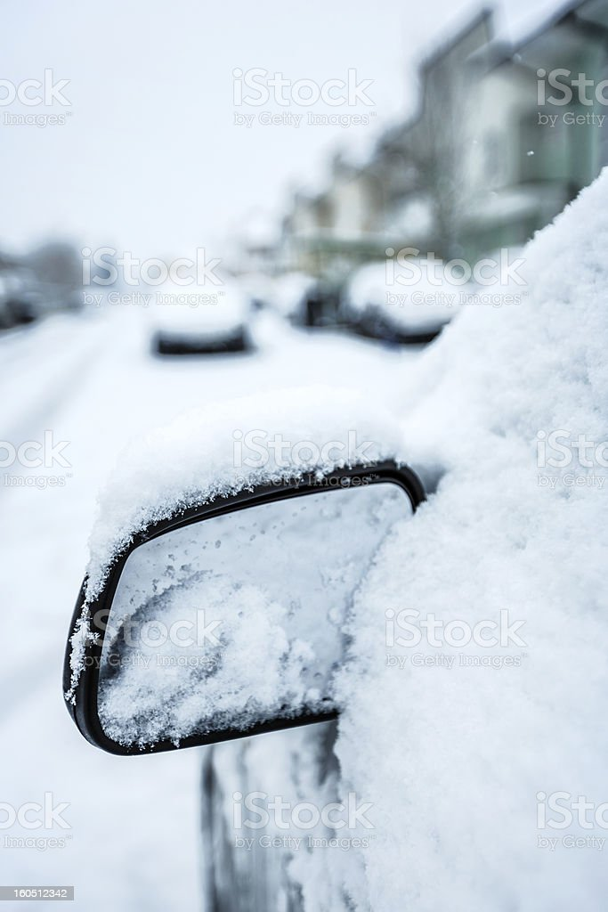Car side view mirror snow-capped royalty-free stock photo