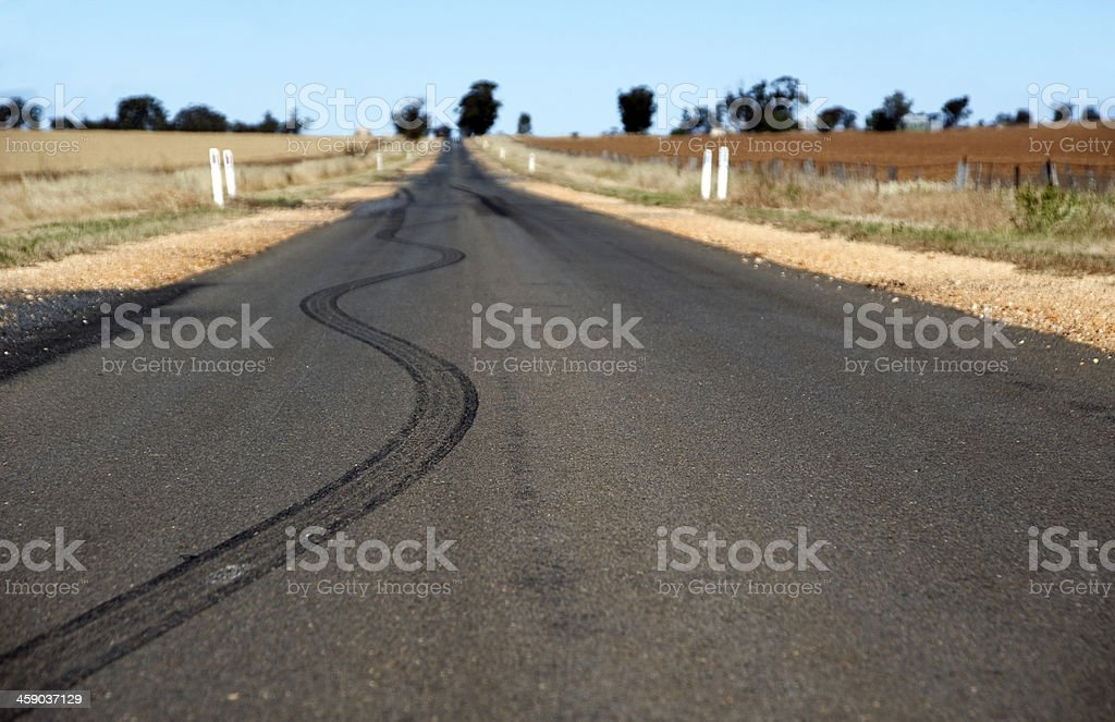 Car skids on country road stock photo