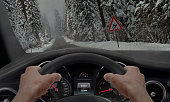 Car slipping on a road in the snow ice. Alongside