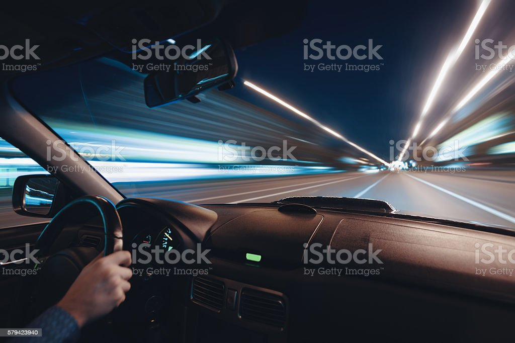 Car speed night drive on the road in city stock photo