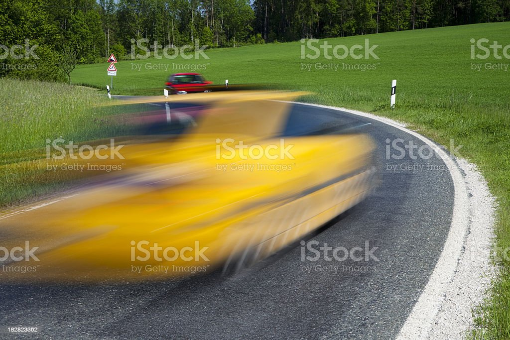 Car Speeding Down Road in Spring, Blurred Motion royalty-free stock photo