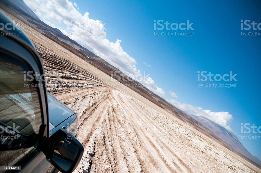 SUV Car Speeding In The Bolivian Desert royalty-free stock photo