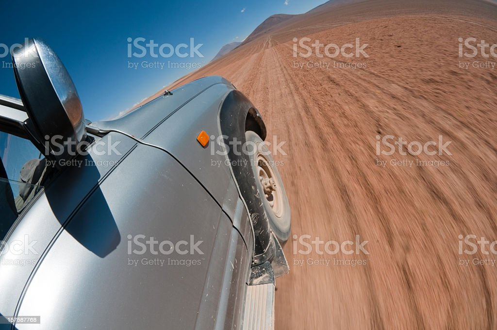 SUV Car Speeding In The Bolivian Desert royalty-free stock photo