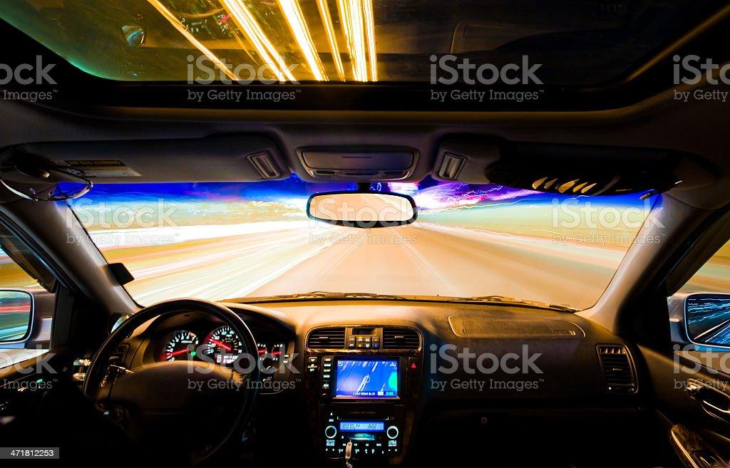 Car Speeding on Las Vegas Boulevard at Night (Long Exposure) stock photo