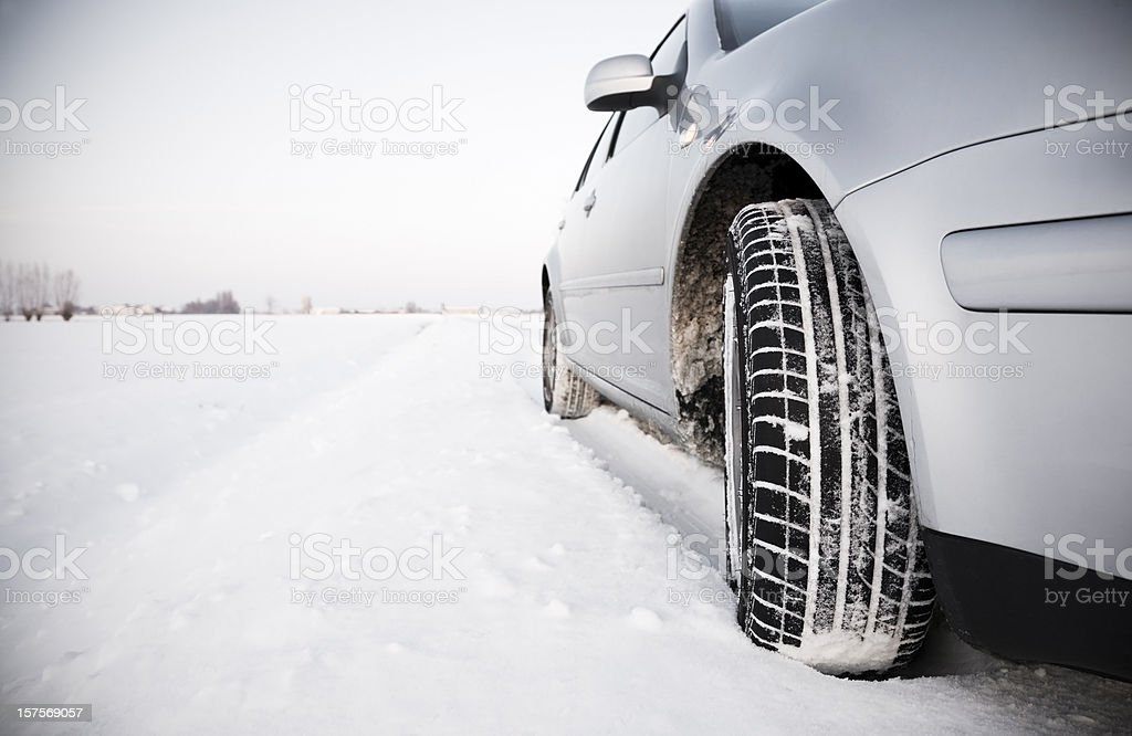 Car standing on a snowy street stock photo