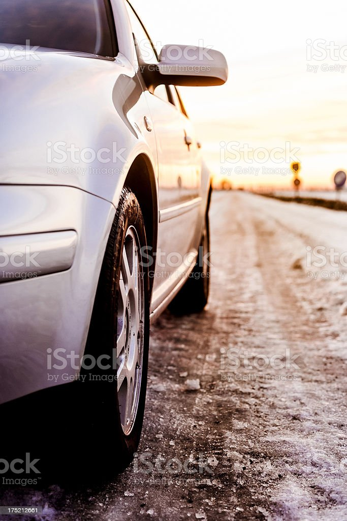Car standing on a snowy street royalty-free stock photo