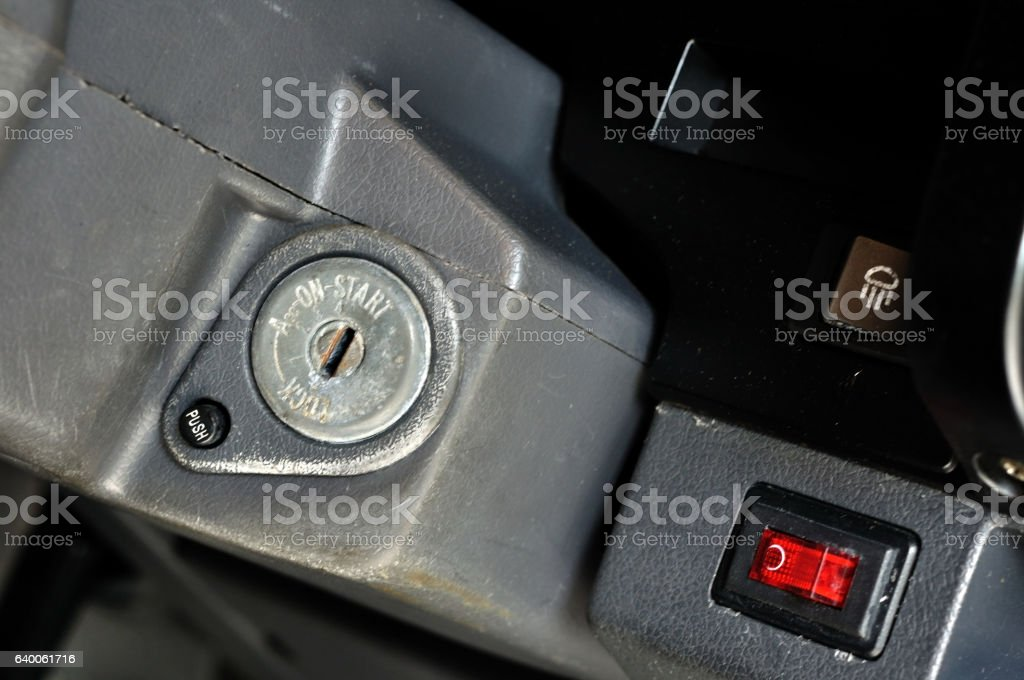 Car starting key socket on off  right side red switch. stock photo