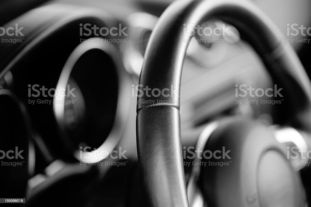 Car steering wheel (trough the windshield) stock photo