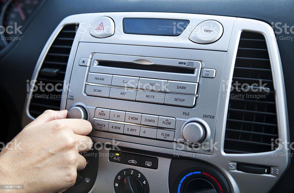 Car Stereo - Adjusting the Volume stock photo