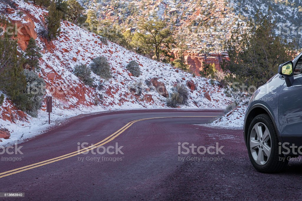 Car stopped beside curvy mountain highway stock photo