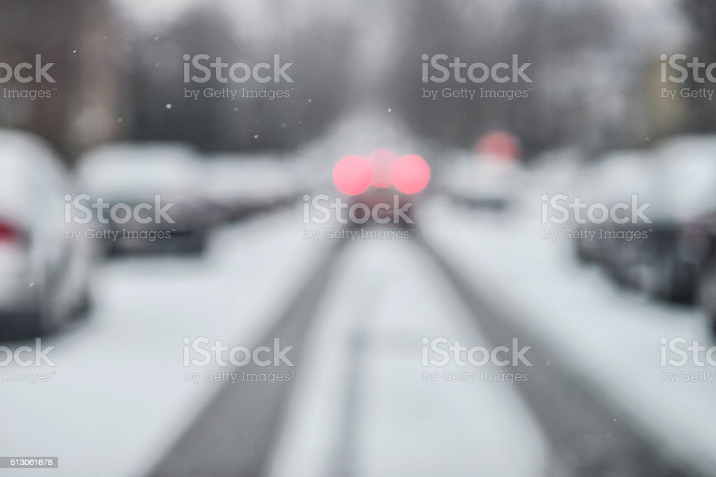 Car Stopping on Snow and Ice Filled Road in Minnesota. stock photo