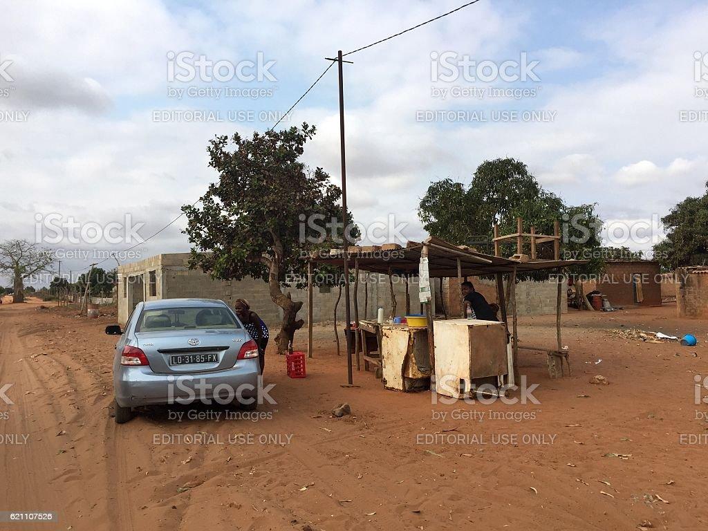 Car stops at roadside stall in rural Luanda, Angola stock photo