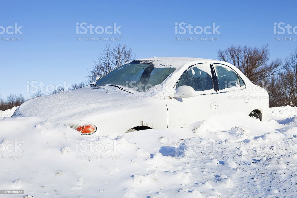 Car Stuck in Snow off a Road royalty-free stock photo