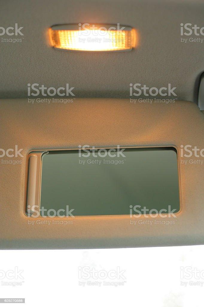 Car sun vizor mirror stock photo