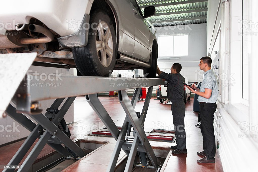 Car suspension system inspection at workshop stock photo