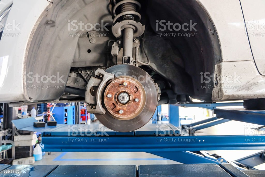 Car take wheel off show drum brake assembly. changing tire. stock photo