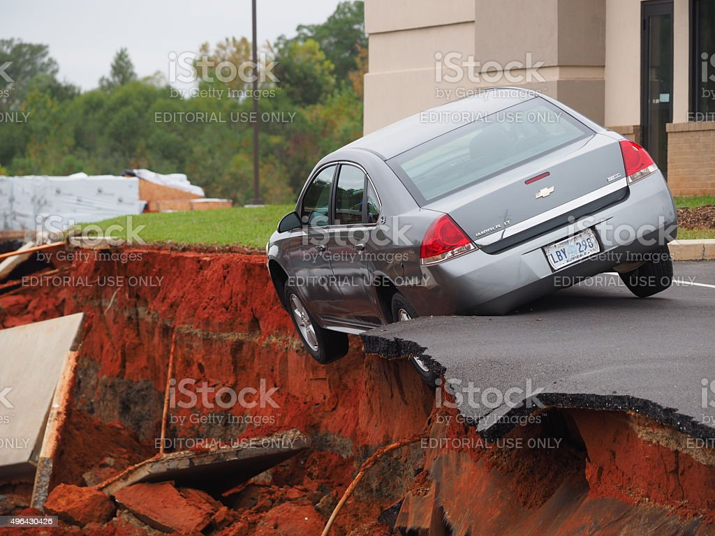 Car Teeters on the Edge of Meridian Mississippi Sink Hole stock photo