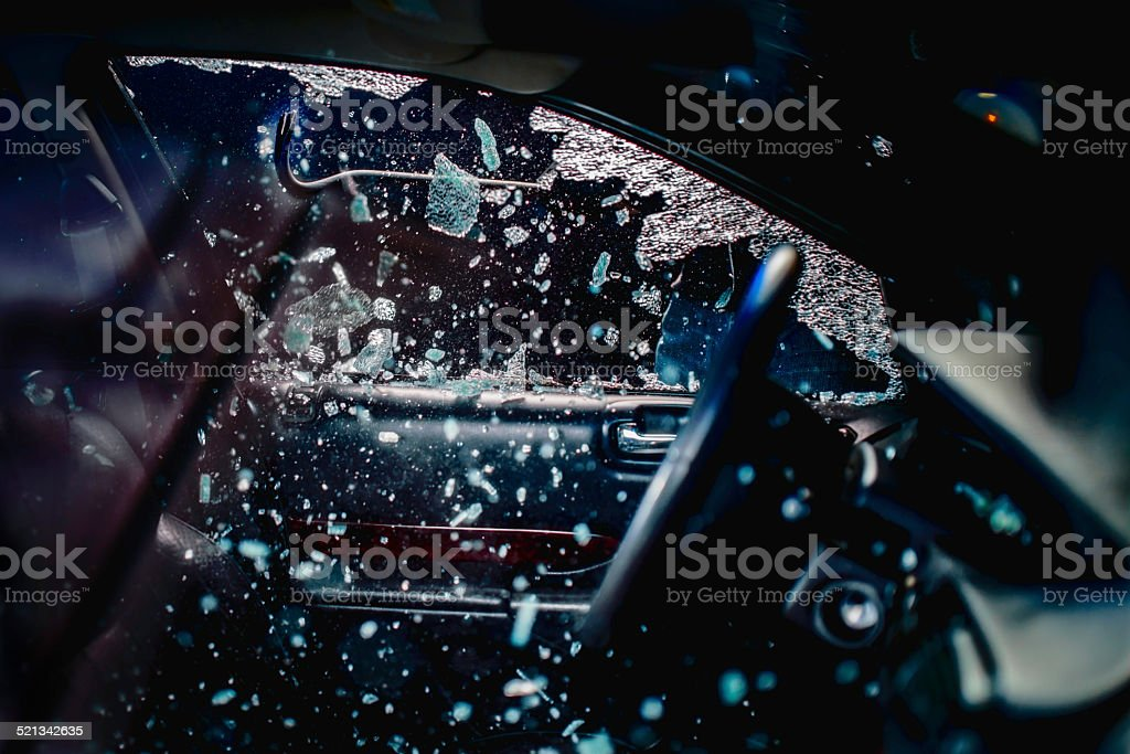 Car Thief Breaking Car Window stock photo