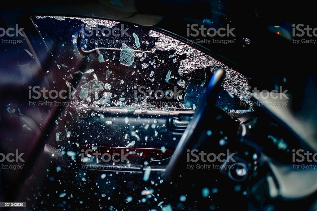Car Thief Breaking Car Window stock photo