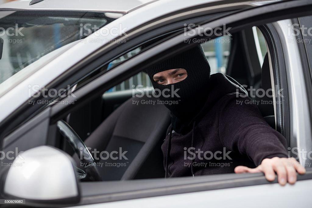 Car Thief gets into a stolen car stock photo
