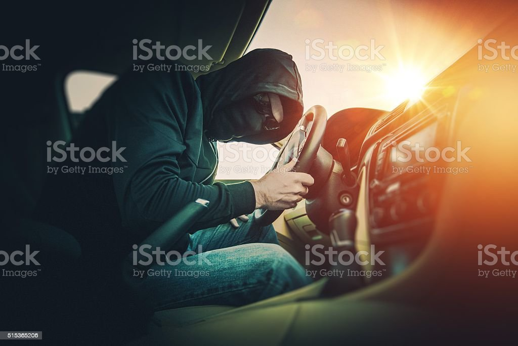 Car Thief in Mask and Glasses stock photo