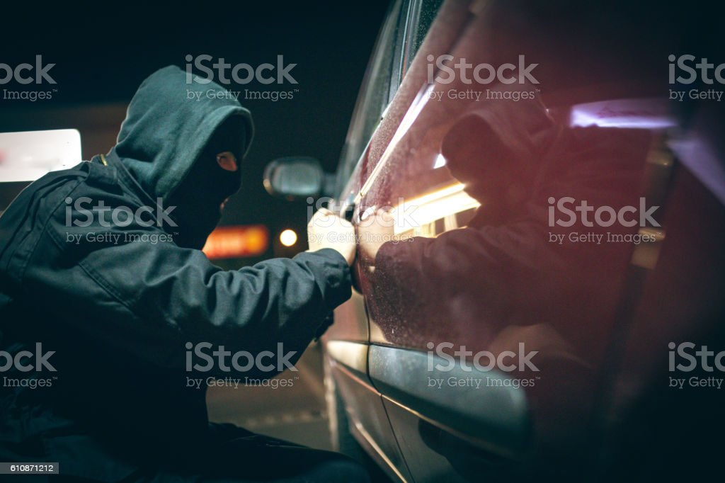 Car thief stock photo